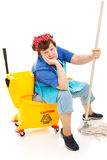 Cleaning Lady - Worn Out. Tired unhappy cleaning lady sitting in her mop bucket. Isolated on white royalty free stock photos