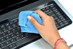 Cleaning laptop keyboard Stock Photo