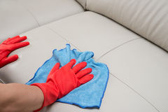 Cleaning leather sofa Stock Photos