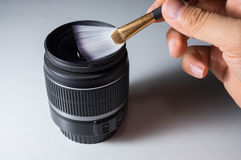 Cleaning lens by brush. Stock Photos