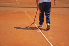 Cleaning line on a tennis court Royalty Free Stock Photography