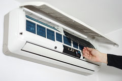 Cleaning and maintaining home air conditioning Stock Image