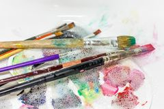 Cleaning and maintenance of artistic brushes. wash with paint br stock images