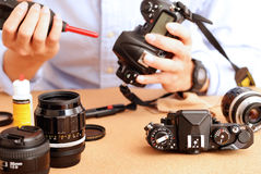 Cleaning and Maintenance. Image of camera cleaning and maintenance Royalty Free Stock Images