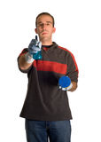 Cleaning Man. A young male wearing rubber gloves, doing some cleaning, isolated against a white background stock photo