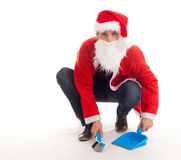 Cleaning man in christmas clothes Stock Image