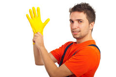 Cleaning man putting latex glove. And prepare to clean house isolated on white background stock images