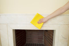 Cleaning a marble fireplace Stock Photography