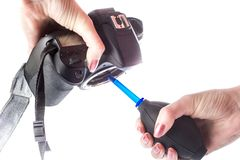 Cleaning matrix SLR camera with air royalty free stock photos