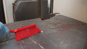 Cleaning meat slicer meat red brush stock video