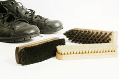 Cleaning of men's boots Royalty Free Stock Photos