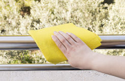 Cleaning metal Railing Royalty Free Stock Images