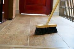 Cleaning miotła na drewnianej podłoga Fotografia Royalty Free