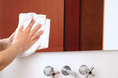 Cleaning mirror Stock Image