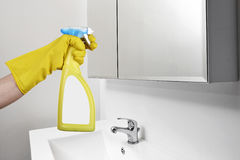 Cleaning mirror in the bathroom Stock Images