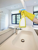 Cleaning mirror in the bathroom Royalty Free Stock Photo