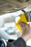 Cleaning mirror in a car Stock Image