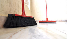 Cleaning mops. A pair of cleaning mops on marble floor Royalty Free Stock Image