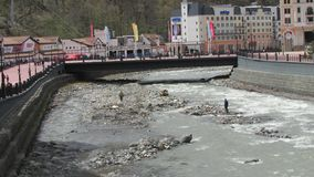 Cleaning of the mountain river after spring rains, Sochi, Rosa Khutor. royalty free stock photo