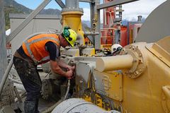 Cleaning the mud pump Stock Images