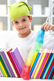 Cleaning my room. Young boy with brush dusting books Royalty Free Stock Images