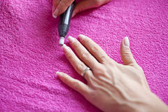 Cleaning nails Royalty Free Stock Image