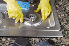 Cleaning Natural Gas Stove Burner Royalty Free Stock Photography