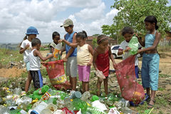 Cleaning of the neighborhood, recycling by children. Brazil, Bahia, Entre Rios, village Conde: village life in rural area. Children, boys and girls, jointly keep Stock Images