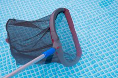 Cleaning net in pool Royalty Free Stock Photo