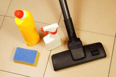 Free Cleaning Of Debris From The Tile Floor Surface With A Brush Vacuum Cleaner. Royalty Free Stock Photo - 213914755