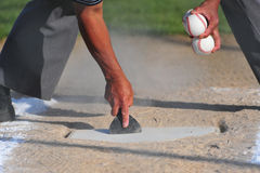 Cleaning off home plate stock photo