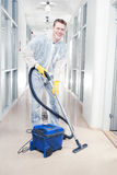 Cleaning office with vacuum Stock Photography