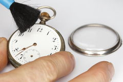 Cleaning old clock Stock Image