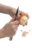 Cleaning the onion (isolated) Royalty Free Stock Images