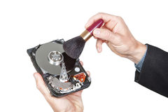 Cleaning open hard disk with brush. Royalty Free Stock Images