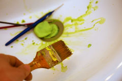Cleaning Paint brushes in the sink by color Stock Photography
