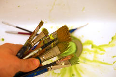 Cleaning Paint brushes in the sink by color Stock Photo