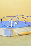 Cleaning a pair of spectacles Stock Photo