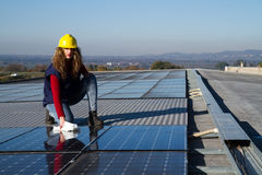 Cleaning the panels. Young woman cleaning photovoltaic panels Stock Images