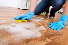 Cleaning a parquet floor Royalty Free Stock Photography