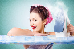Cleaning pin-up housewife with hot clothing iron Royalty Free Stock Image