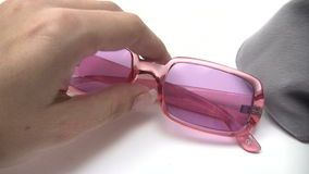 Cleaning Pink Sunglasses Stock Photos