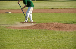 Cleaning the pitcher's mound after a game Royalty Free Stock Photography