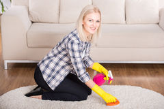 Cleaning. Portrait of woman is doing some cleaning work in the house royalty free stock photography