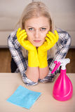 Cleaning. Portrait of woman is doing some cleaning work in the house royalty free stock image
