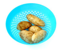Cleaning potatoes Stock Images