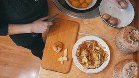 Cleaning Potatoes in the Home Kitchen stock video footage