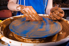 Cleaning of the pottery wheel Royalty Free Stock Image