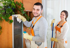 Cleaning premises team to work. Cleaning premises happy team in uniform  is ready to work Royalty Free Stock Photos
