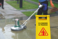Cleaning in process and caution wet floor symbol Stock Images